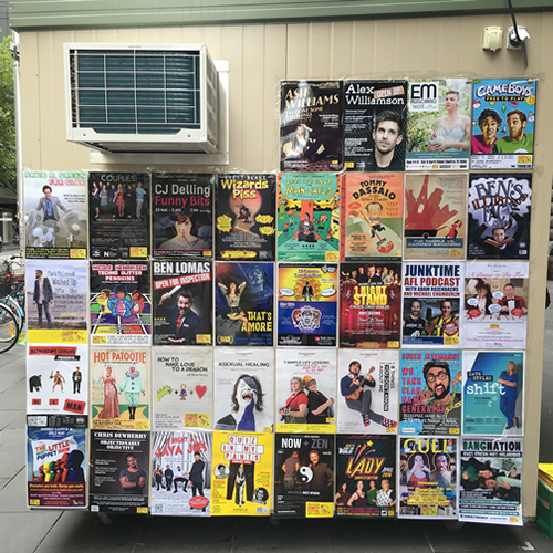 Posters on the MICF info booth outside Melbourne Town Hall, 24 March 2016